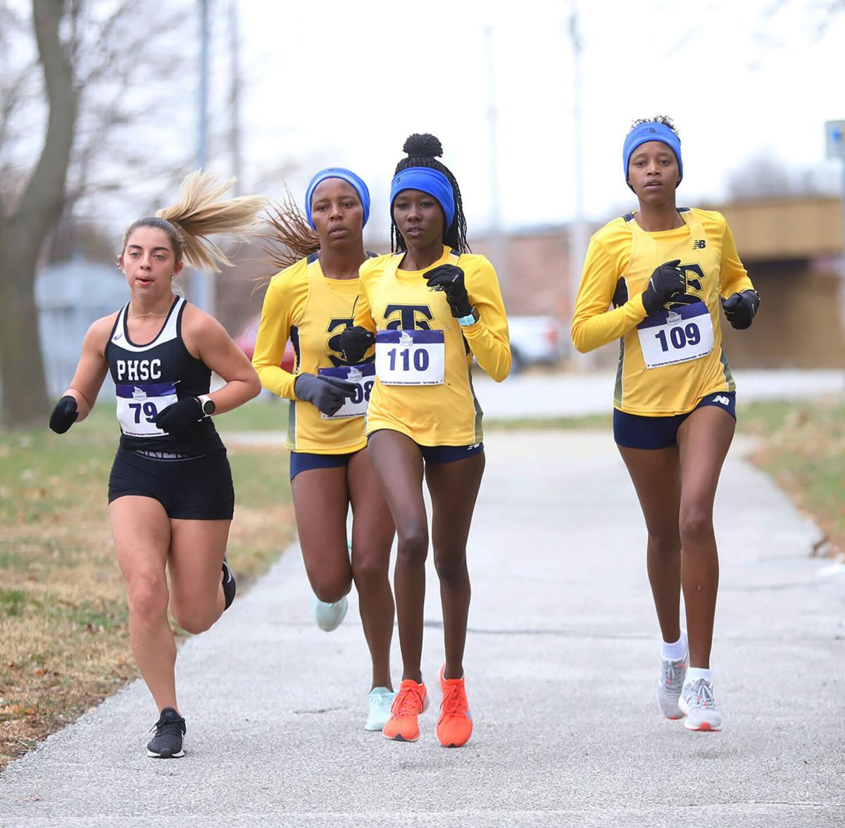 Lady Trojans make history at half  marathon competition — take home national title, national coach of the year