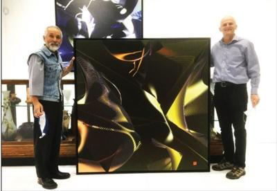 Fumio Sawa, left, stands with business partner Walter Bowman with his art piece titled 'Solitude.'