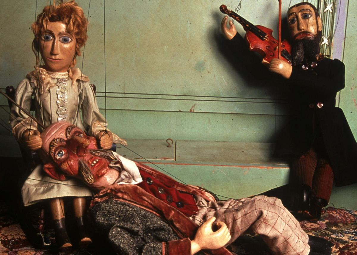 Master Puppeteer Vít Horejš with one of his many antique Czech marionettes.