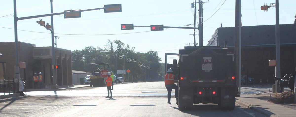 Blocking traffic on intersection of Grand Ave and TX Hwy 16 near Comanche Square