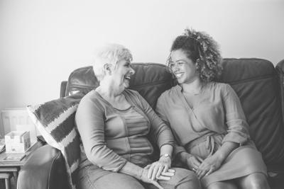 Elderly Woman With Younger Caregiver