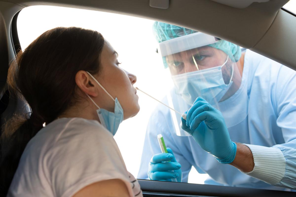 Woman getting tested at a coronavirus drive thru station