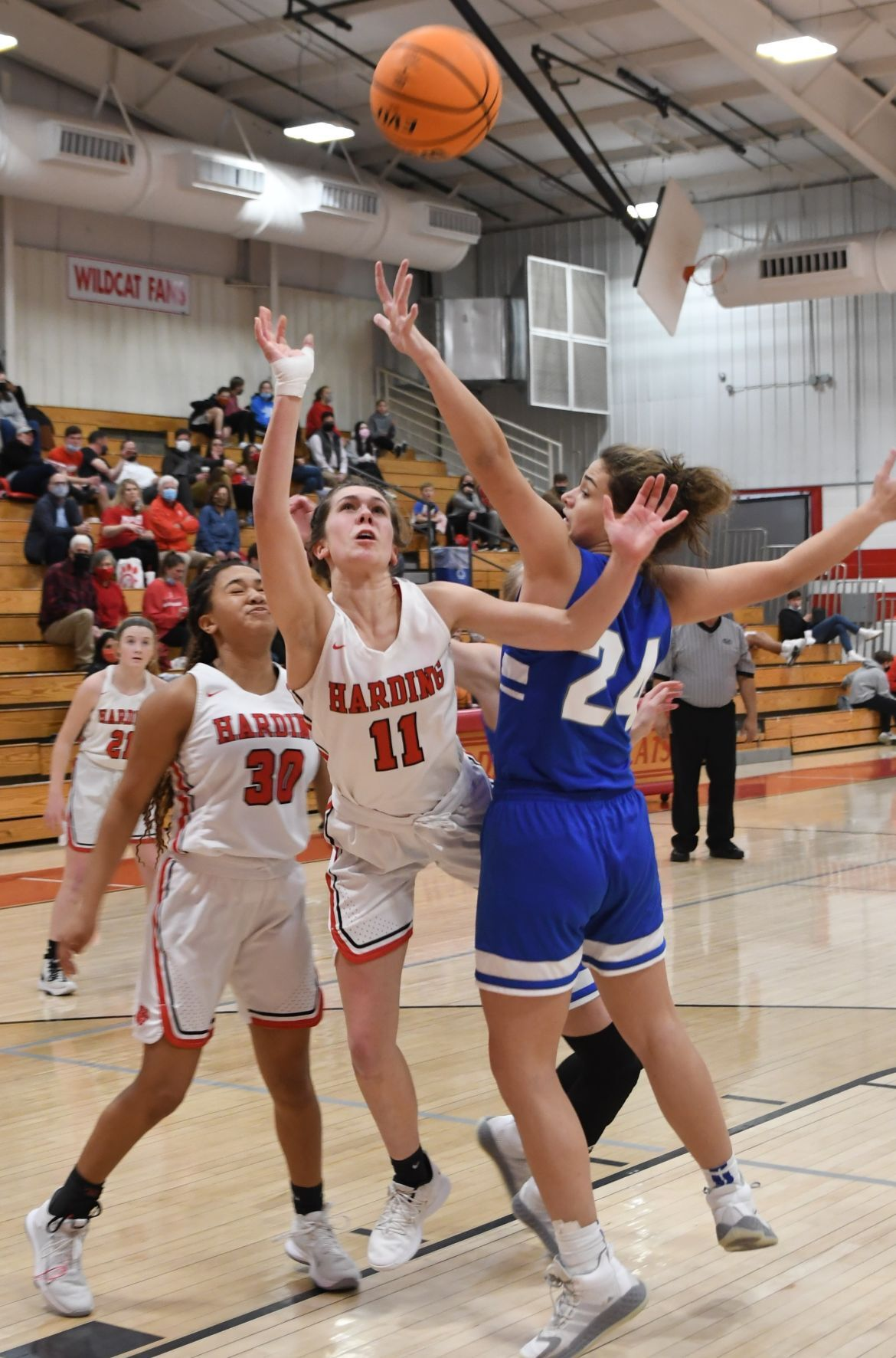 Harding Academy's Claire Cullins fights to get off shot