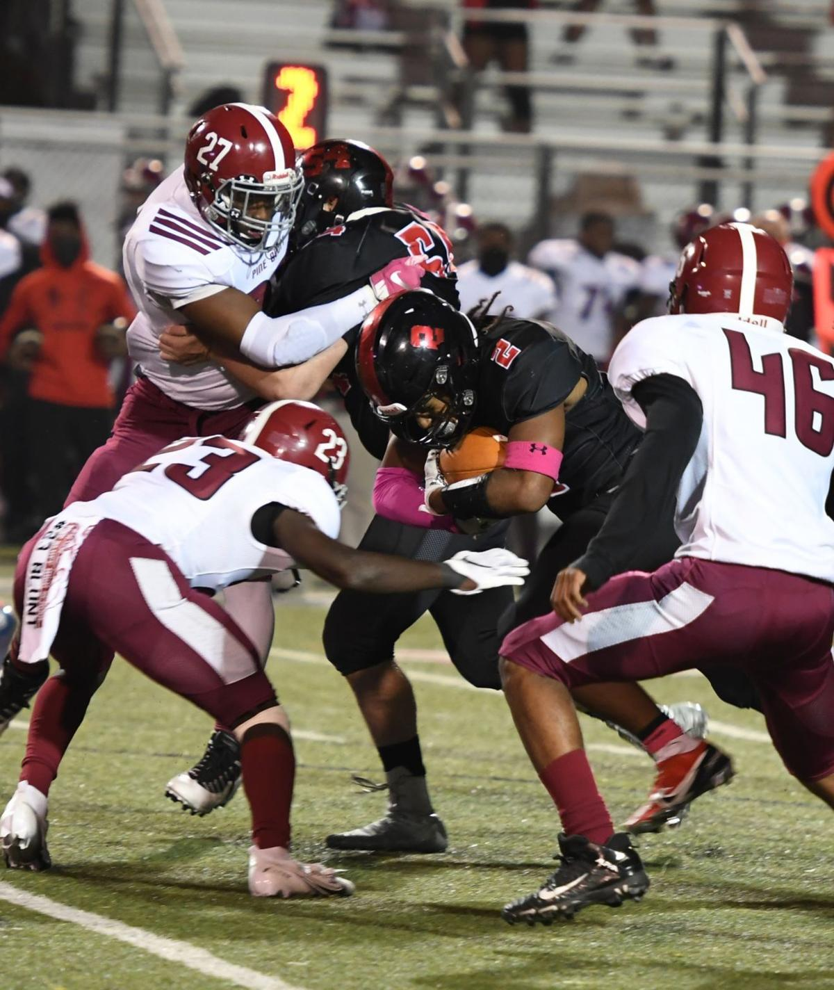 Searcy's Daniel Perry Jr. plows through Pine Bluff defense
