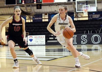 Harding's Carissa Caples drives with ball