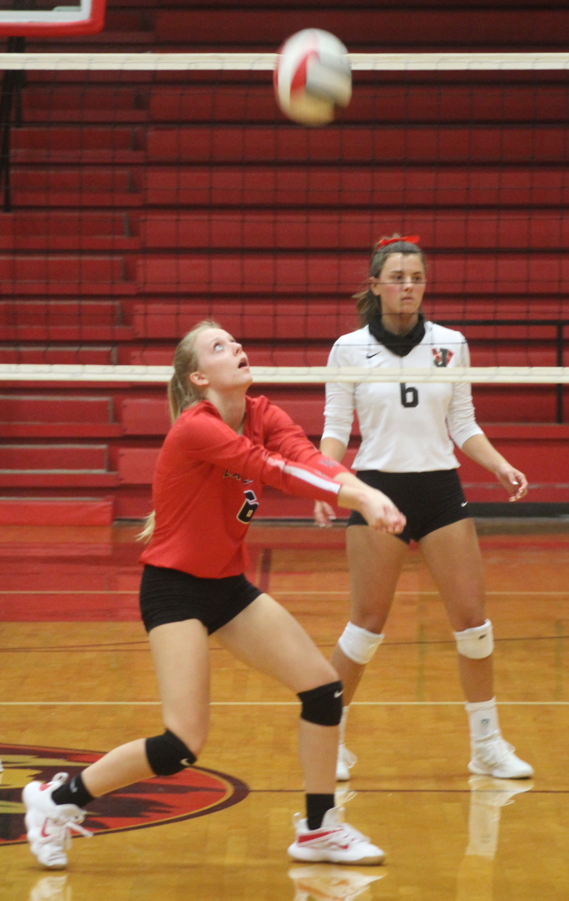 Searcy's Karlie Hite sets the ball against Jonesboro