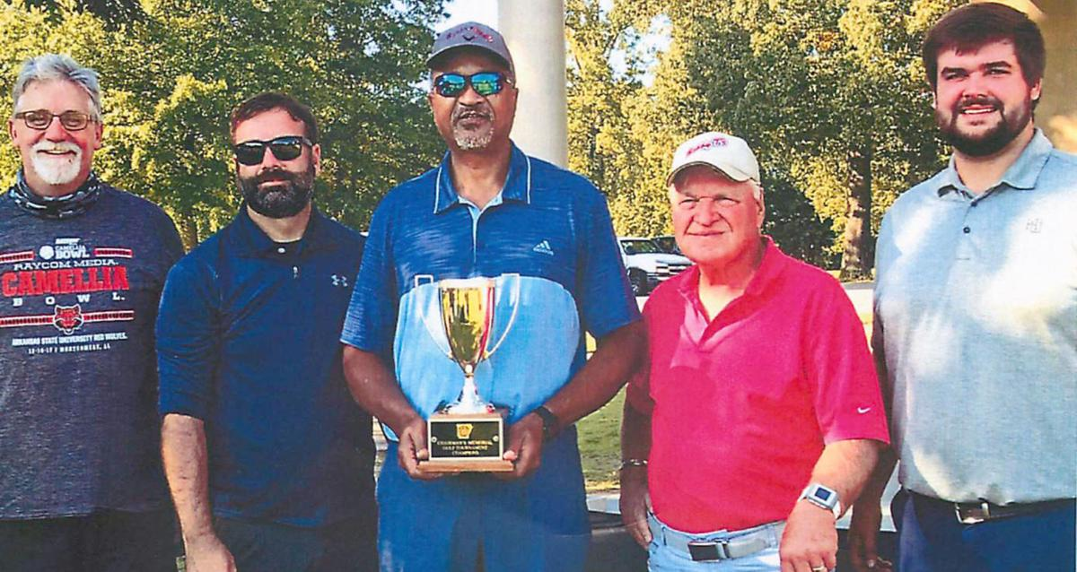 Golf tournament winners celebrate