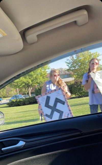 Swastikas at protest in Geneseo Organizers of vaccine mandate protest distance themselves from 'misleading' posters