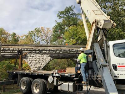 Avon working to restore iconic span Crews installing roof, drainage system on bridge