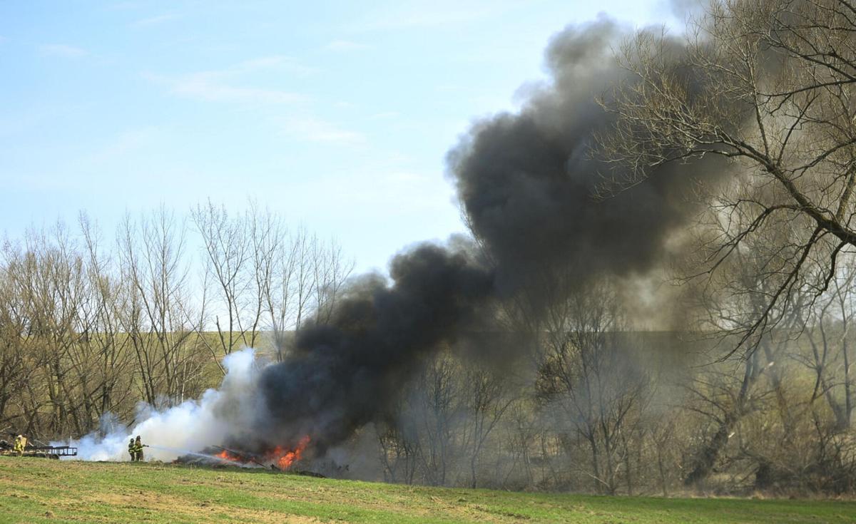 Firefighters battle grass fire in Attica