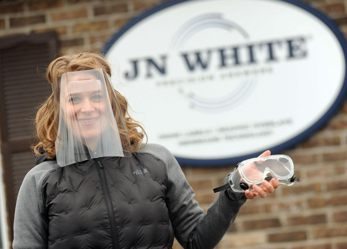 JN White producing protective masks