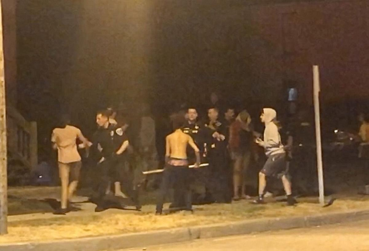 6 face rioting charges after street brawl