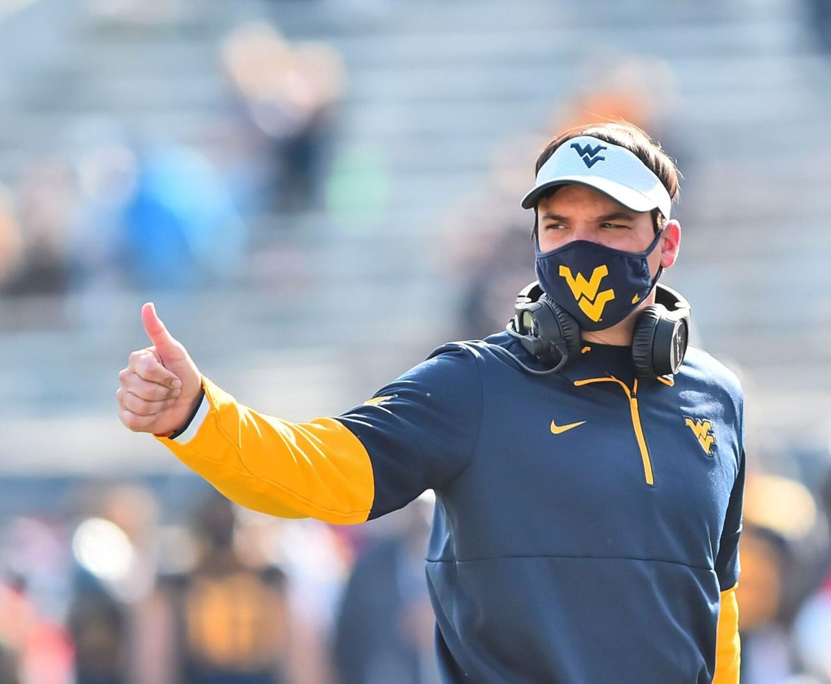 West Virginia head coach Neal Brown gives a thumbs up in a 24-6 victory against TCU on Nov. 14, 2020.