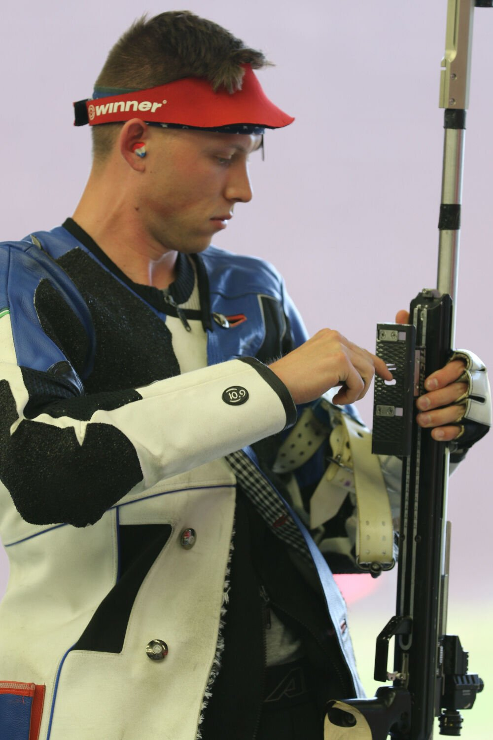 US Army Sergeant Patrick Sunderman examines his rifle during Olympic Trials in Fort Benning, Georgia, on May 26, 2021.