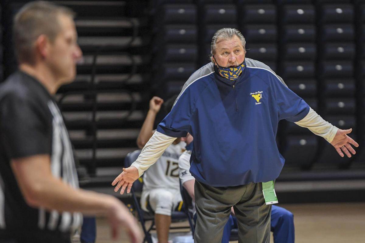 West Virginia head coach Bob Huggins questions a call made by the officials during WVU's game against Northeastern on Dec. 29, 2020 at the WVU Coliseum in Morgantown, W.Va.