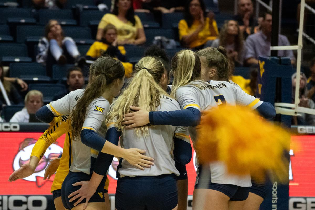 Members of the West Virginia volleyball team huddle up during their match against Iowa State on October 5, 2019.