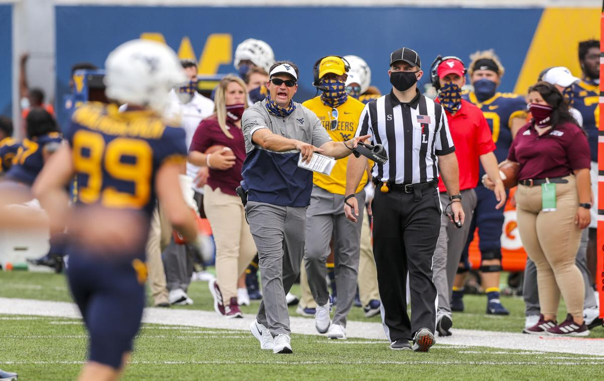 West Virginia Mountaineers head coach Neal Brown yells along the sidelines during the third quarter against the Eastern Kentucky Colonels at Mountaineer Field at Milan Puskar Stadium.
