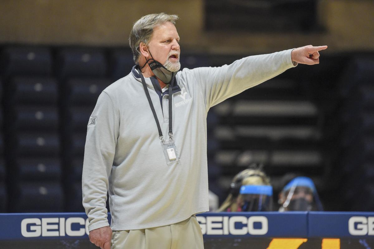 WVU head coach Mike Carey guides his players against Texas Tech at the WVU Coliseum in Morgantown, W.Va., on Jan. 13, 2021.