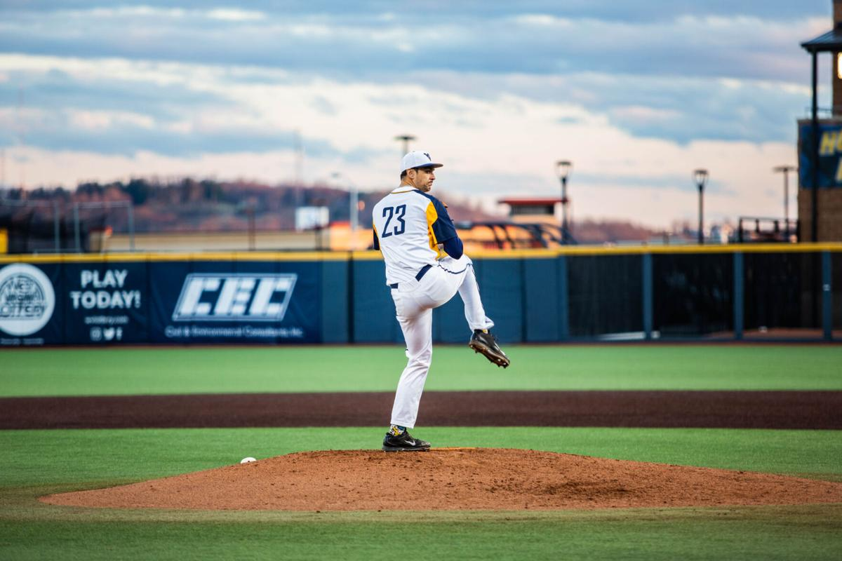 WVU pitcher Jackson Wolf goes into his windup against the Kansas Jayhawks on March 26, 2021, in Morgantown, W.Va.