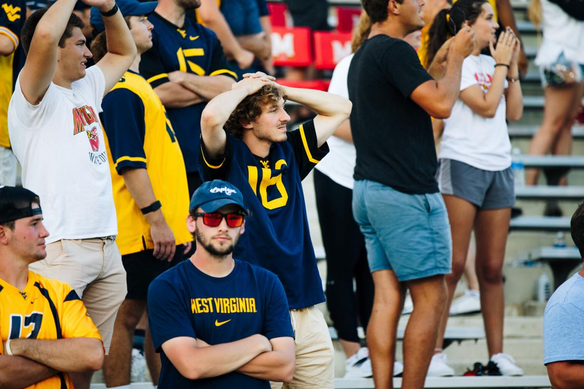 A West Virginia fan grimaces during the second half of the game between the West Virginia Mountaineers and the Maryland Terrapins at Capital One Field at Maryland Stadium in College Park, MD on Sept. 4, 2021.