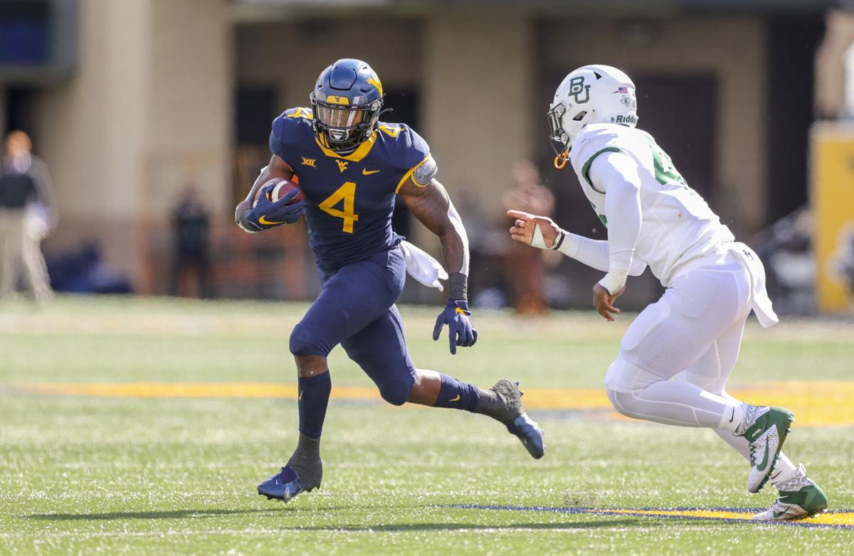 West Virginia Mountaineers running back Leddie Brown (4) runs the ball during the third quarter against the Baylor Bears at Mountaineer Field at Milan Puskar Stadium.