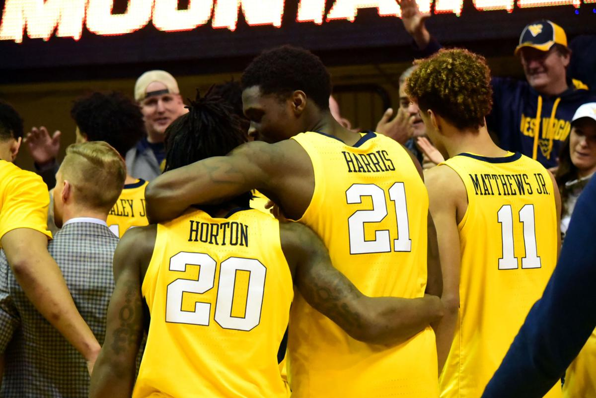 WVU's Horton, Harris, and Mattews Jr. celebrate the mountaineer victory over the Oklahoma Sooners.