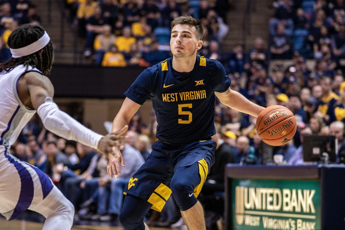 WVU's Jordan McCabe looks to pass the ball against Kansas State on February 1, 2020 at the WVU Coliseum.