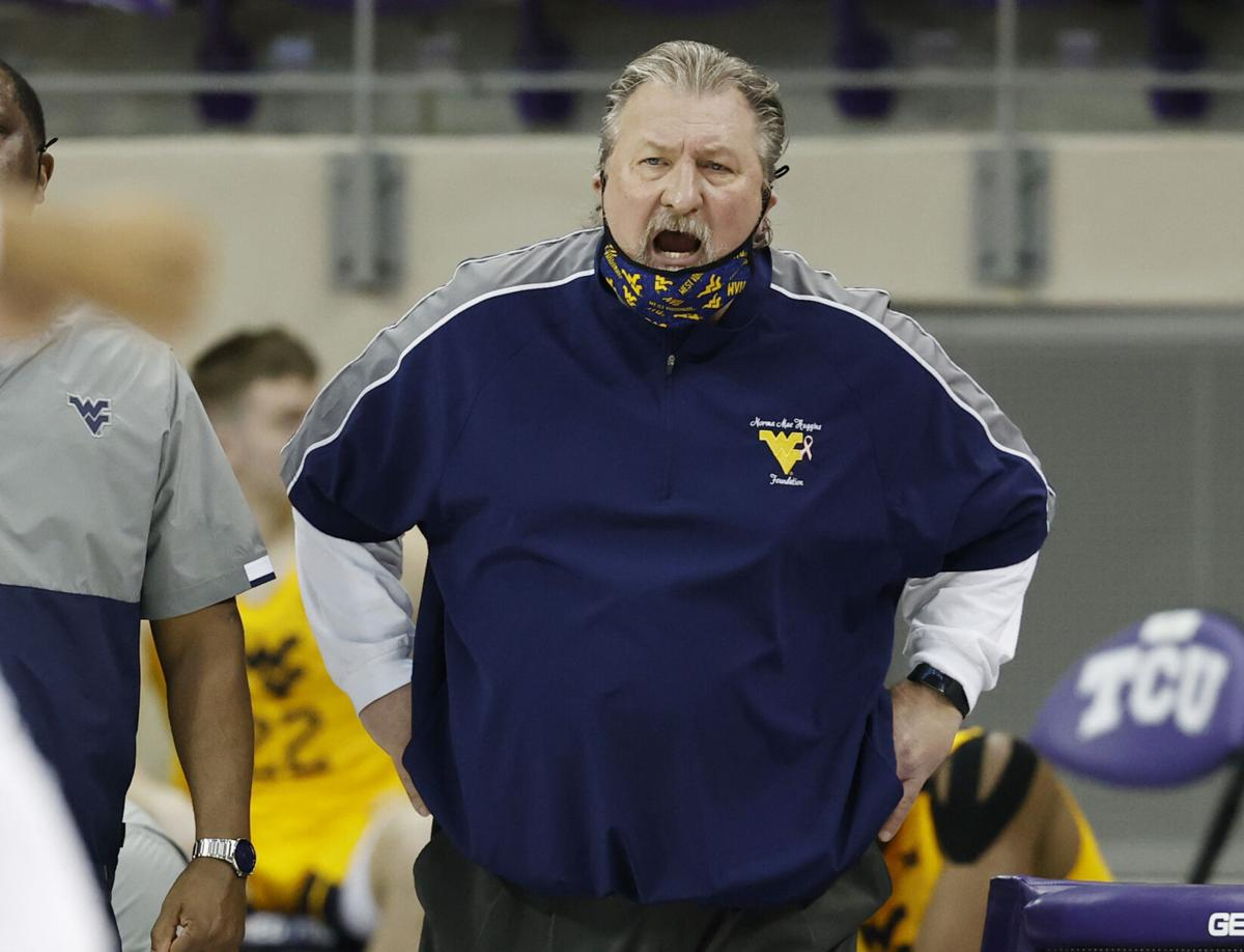 West Virginia head men's basketball coach Bob Huggins coaches his team against the TCU Horned Frogs in Fort Worth, Texas, on Feb. 23, 2021.