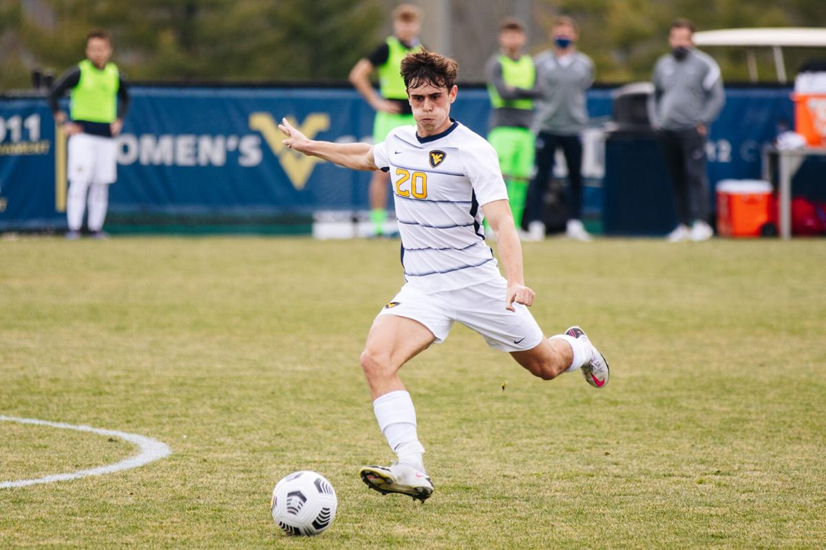 West Virginia University midfielder Sergio Ors Navarro drives with the ball during a match at Dick Dlesk Stadium on March 17, 2021.