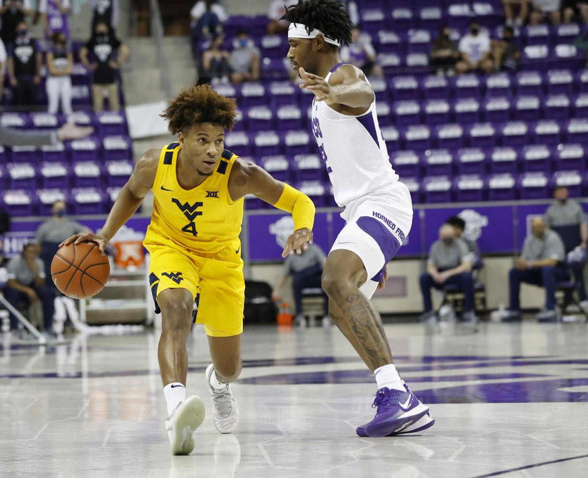 WVU guard Miles McBride drives past a TCU defender in Fort Worth, Texas, on Feb. 23, 2021.