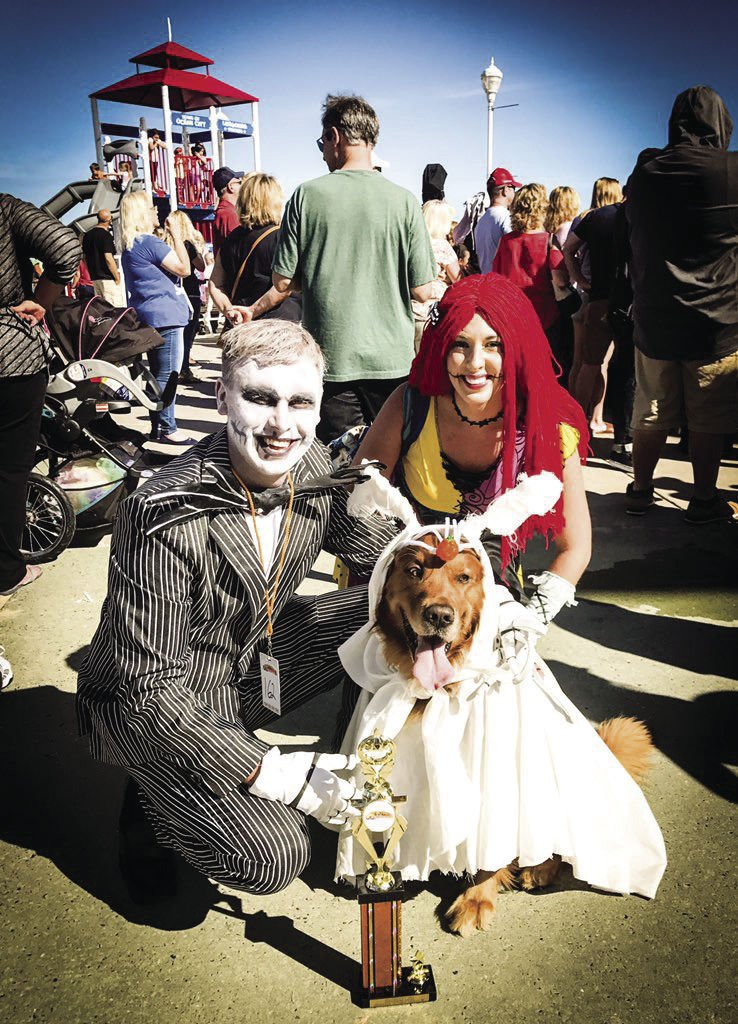 Bogey and his WVU alum parents pose in their Nightmare Before Christmas themed Halloween costumes. His brother is also a Hearts of Gold Service Dog.