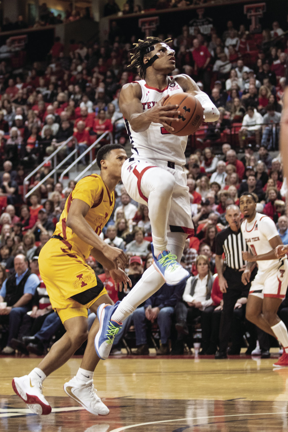 Texas Tech's Jahmi'us Ramsey goes up for a dunk against Iowa State.