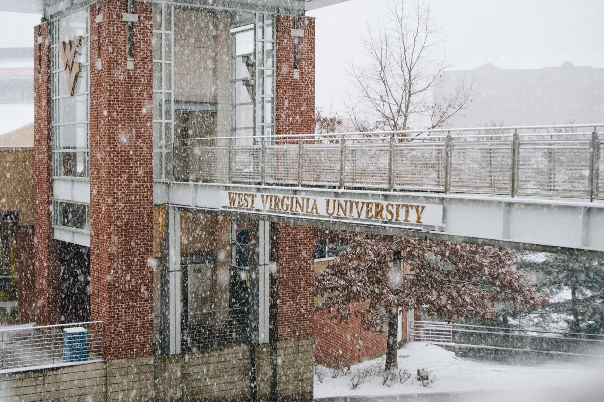 A snow-filled bridge on campus adorned with the words