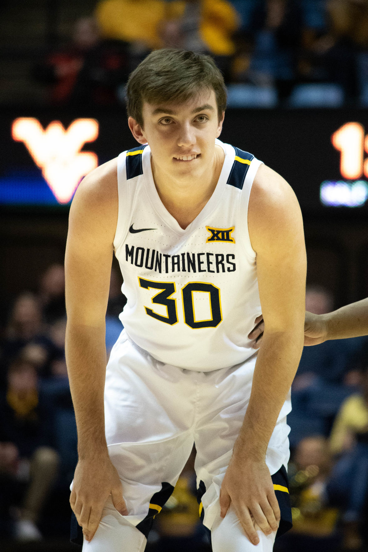 West Virginia guard Spencer Macke observes during a break in the action.