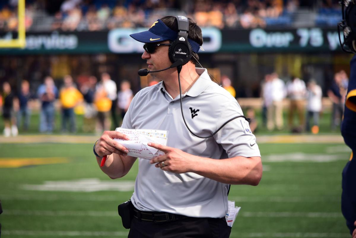 West Virginia head coach Neal Brown watches the play from the sideline against James Madison.