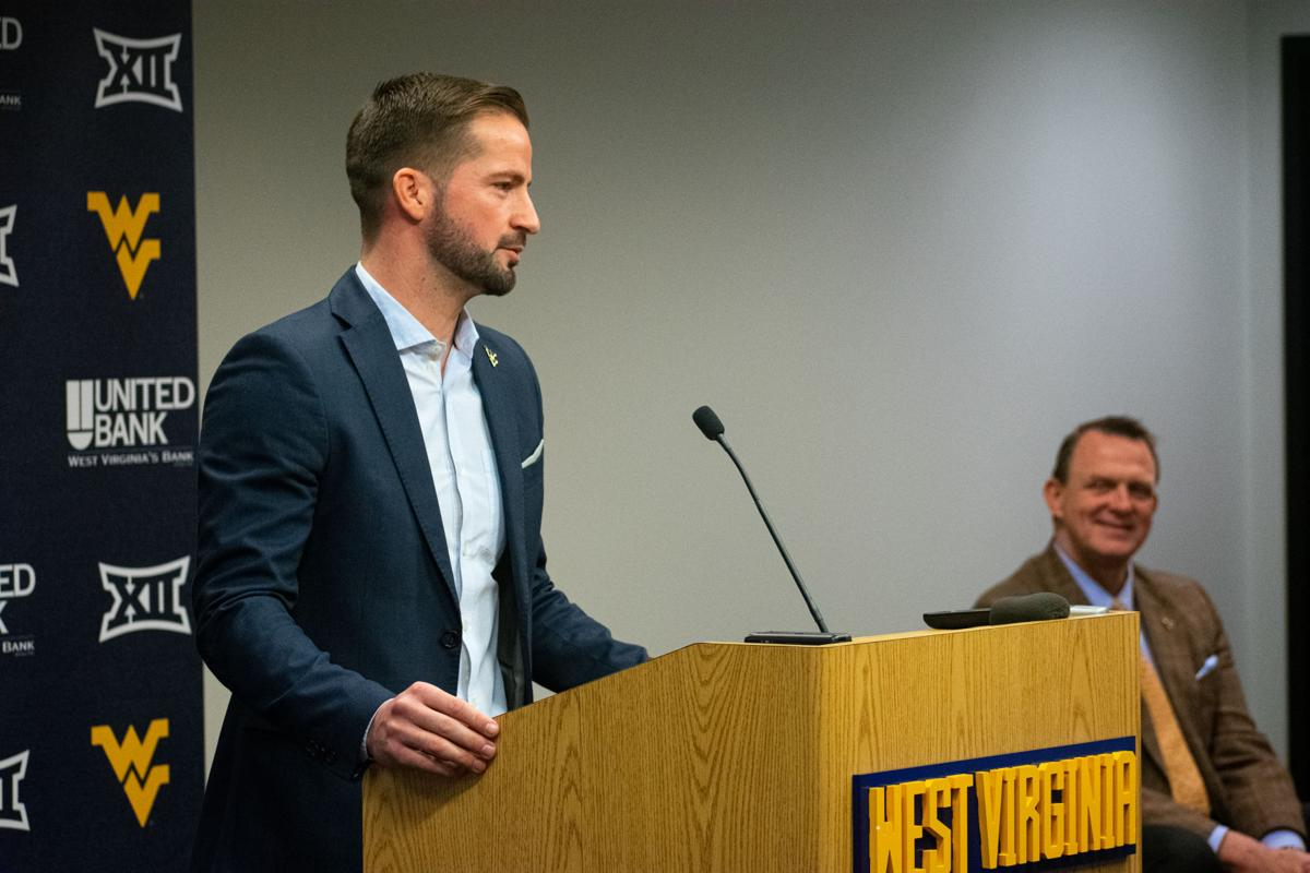 Jan. 25, 2020. Men's soccer head coach Dan Stratford speaks at his introductory press conference as WVU Director of Athletics Shane Lyons listens.