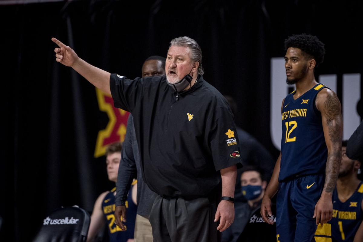 West Virginia head coach Bob Huggins directs the Mountaineers during West Virginia's game against Iowa State in Ames, Iowa, on Feb. 2, 2021.