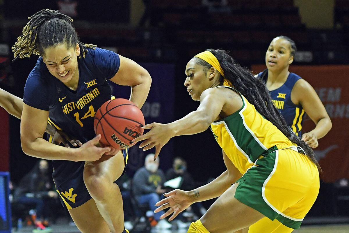 West Virginia forward Kari Niblack (14) loses possession of the ball against the Baylor Lady Bears in the Big 12 Championship game in Kansas City, Missouri, on March 14, 2021.