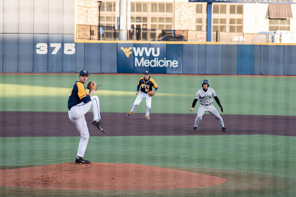Pitcher Jackson Wolf and short-stop Mikey Kluska versus Coastal Carolina in the Monongalia County Ballpark in Morgantown, W.Va., on March 19, 2021.