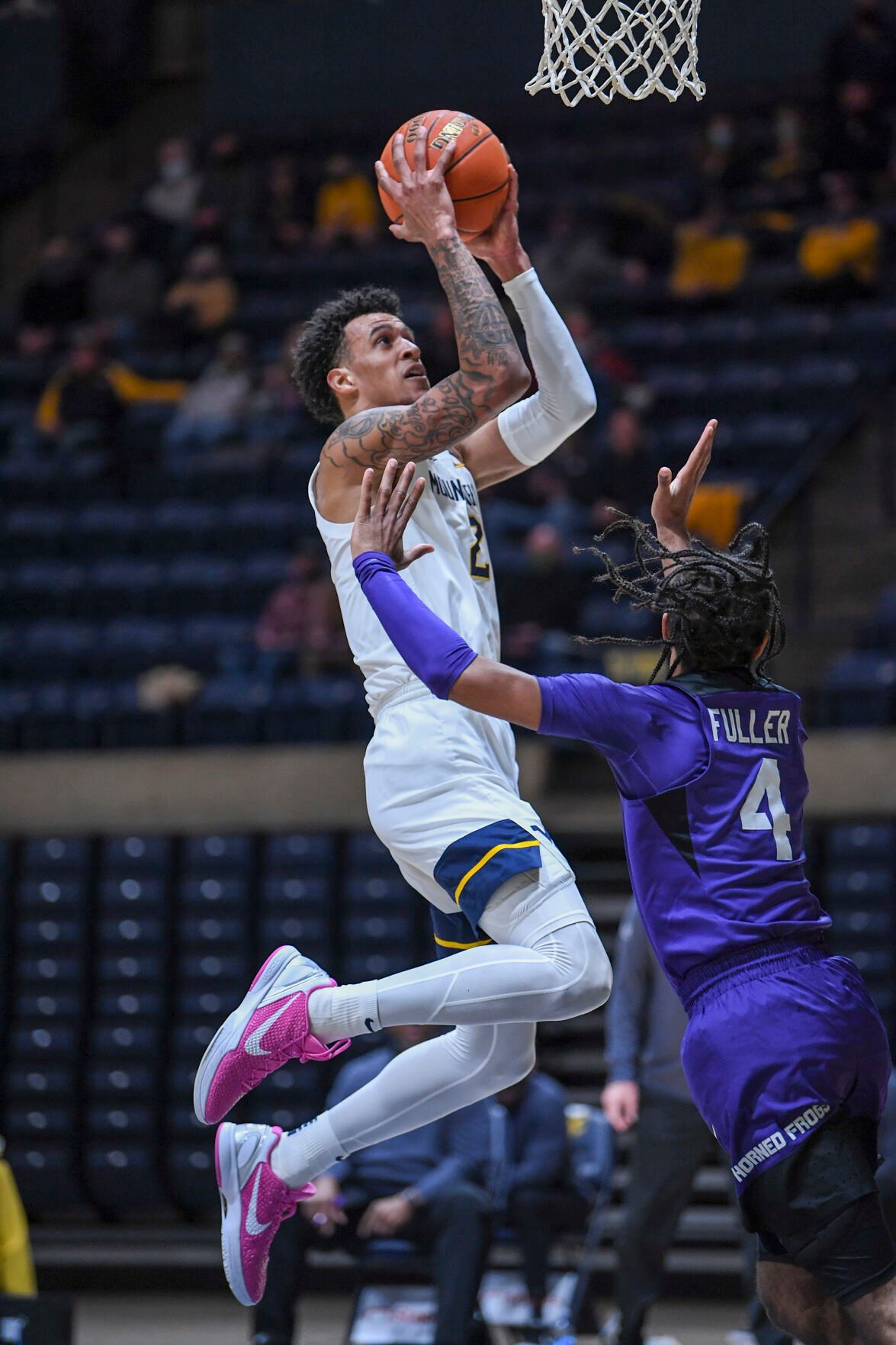 West Virginia forward Jalen Bridges soars to the rim against the TCU Horned Frogs at the WVU Coliseum on March 4, 2021.