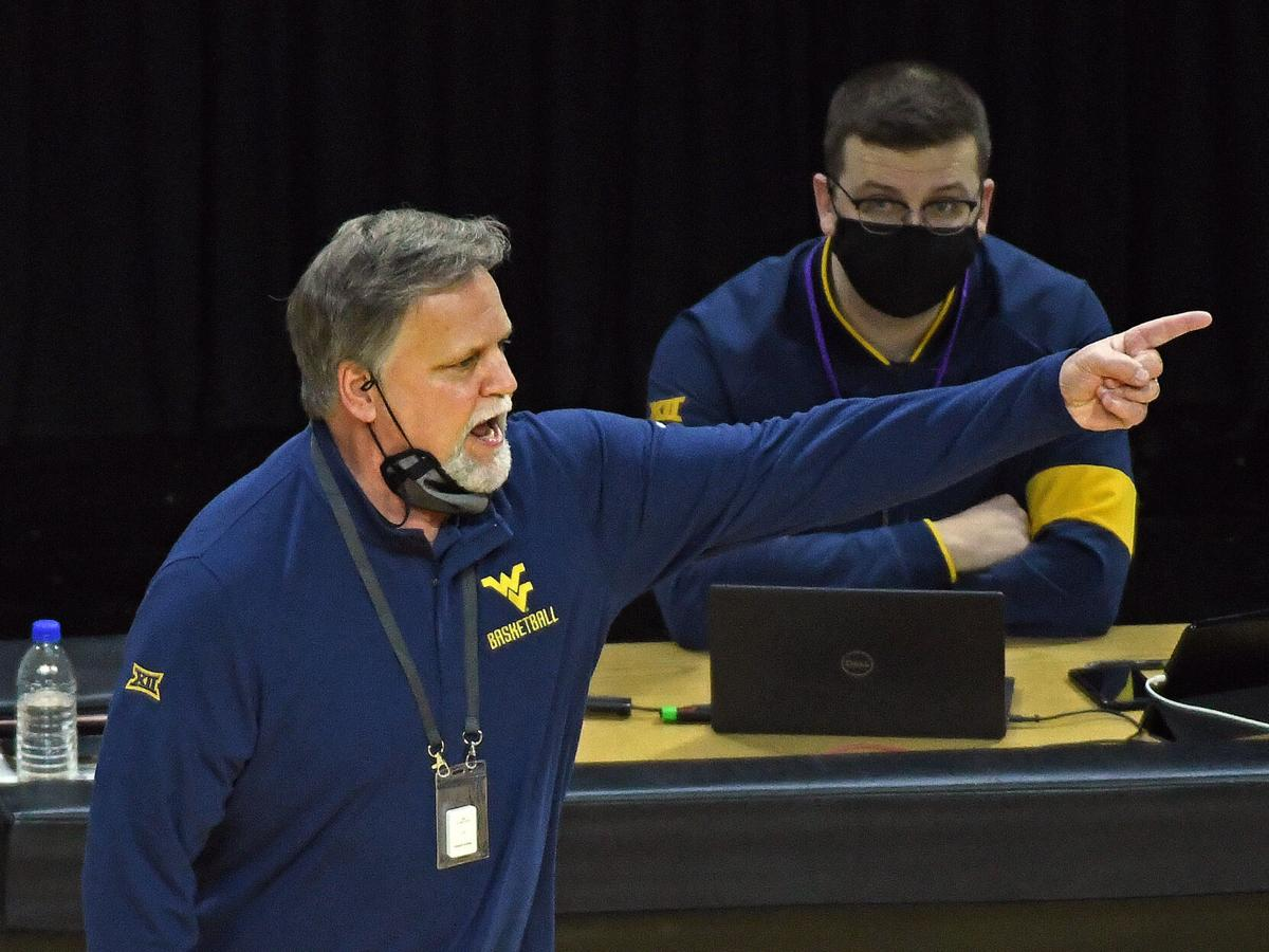 West Virginia head coach Mike Carey motions to his team during WVU's game against Kansas State on March 3, 2021.