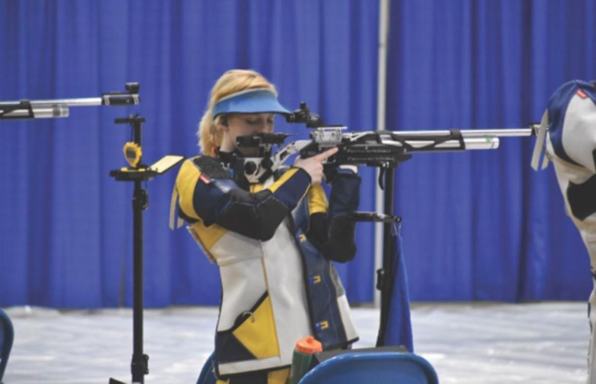 Ginny Thrasher aims with her rifle