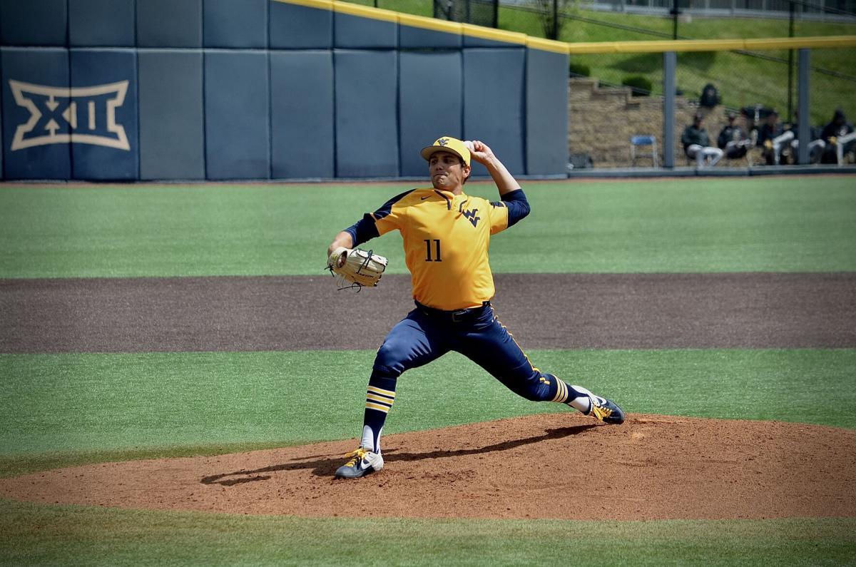 West Virginia left-handed pitcher Ben Hampton delivers a pitch against Texas Tech on April 18, 2021.