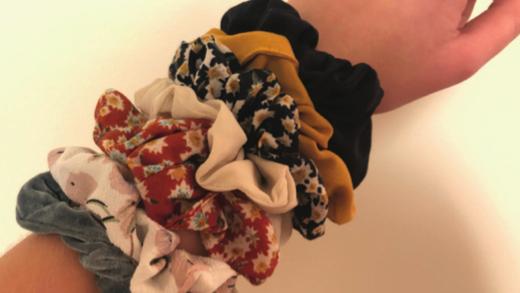 A personal collection of scrunchies with multiple patterns and textures.
