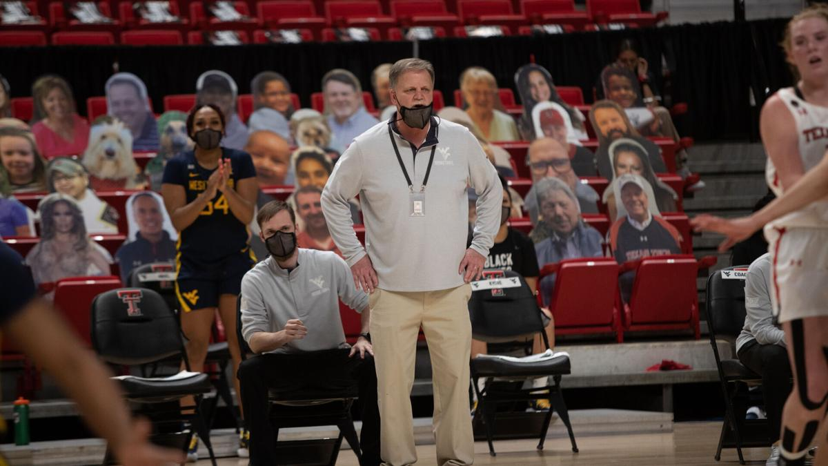 West Virginia head basketball coach Mike Carey looks on as the Mountaineers face Texas Tech on Jan. 27, 2021.