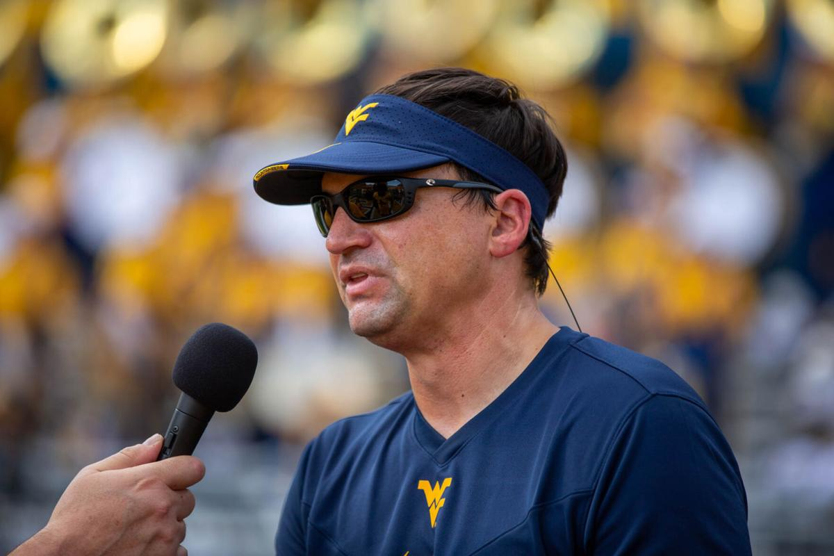 West Virginia head coach Neal Brown answering questions following West Virginia's 27-21 win over No. 15 Virginia Tech on Sept. 18, 2021.