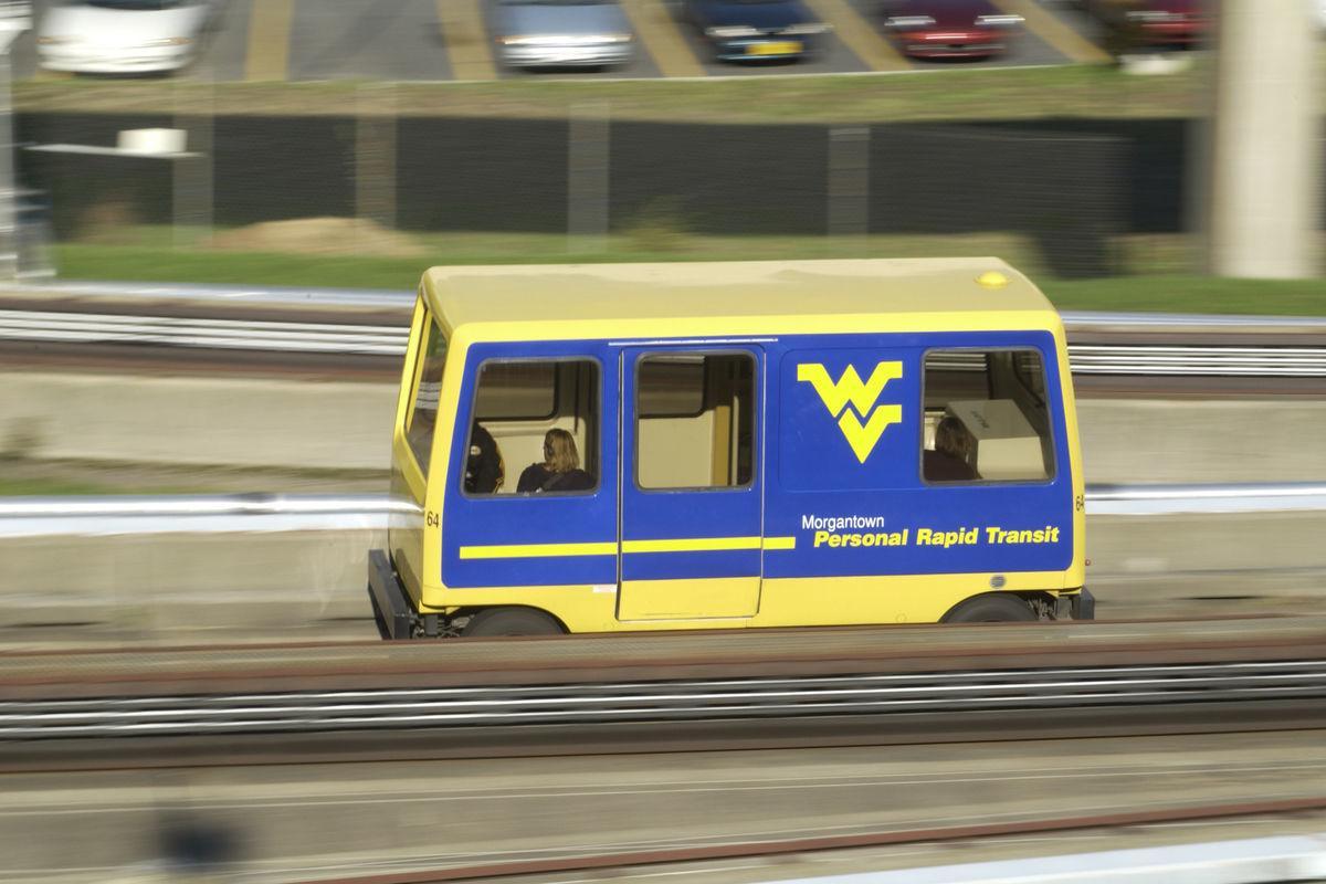 A WVU PRT car travels along the rail.