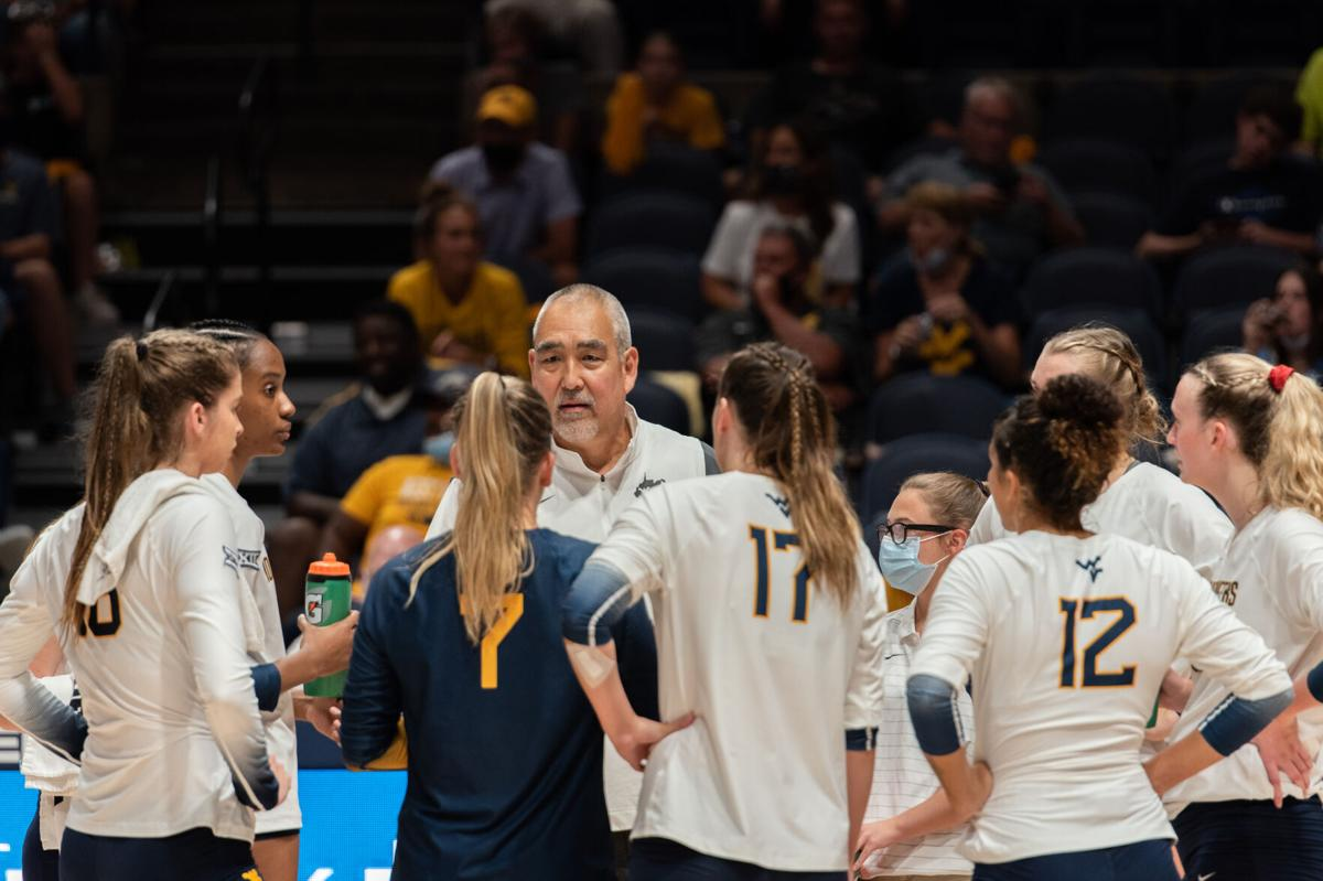 West Virginia head coach Reed Sunahara talks to his team during a timeout against Penn State at the WVU Coliseum on Sept. 17, 2021.