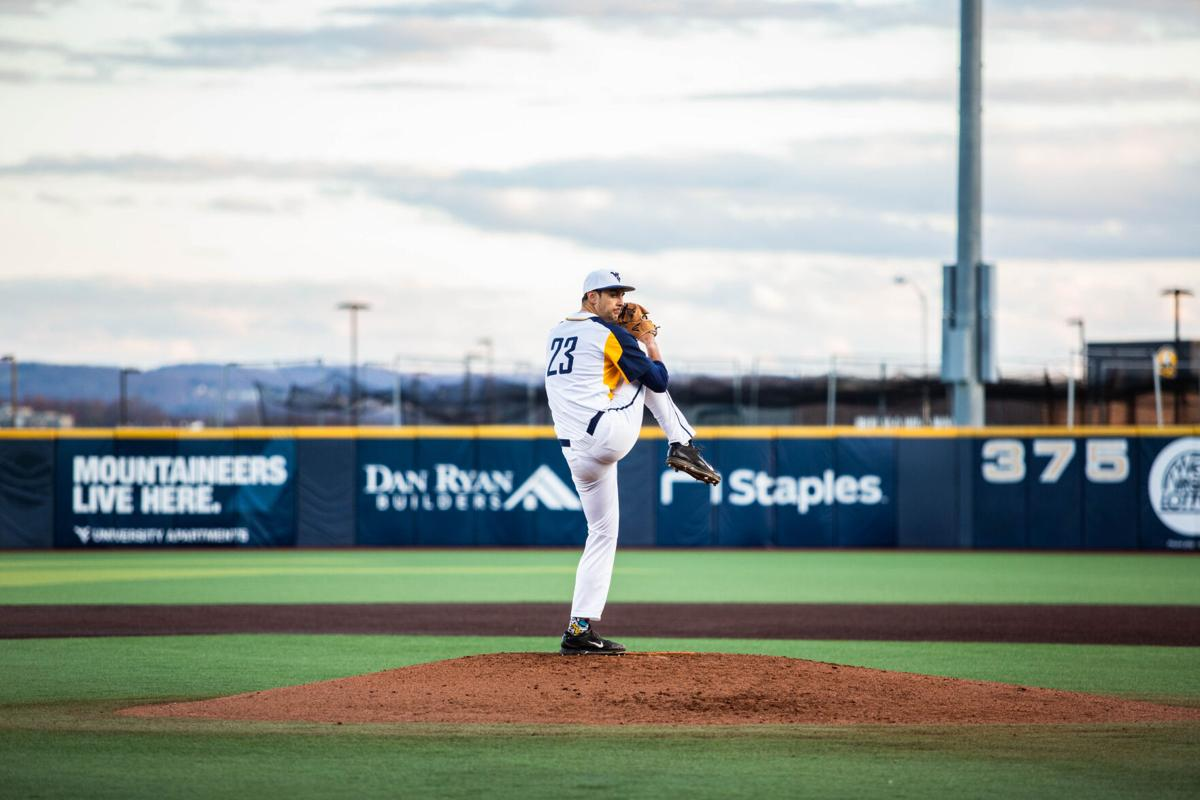 West Virginia pitcher Jackson Wolf goes into his windup against the Kansas Jayhawks on March 26, 2021.