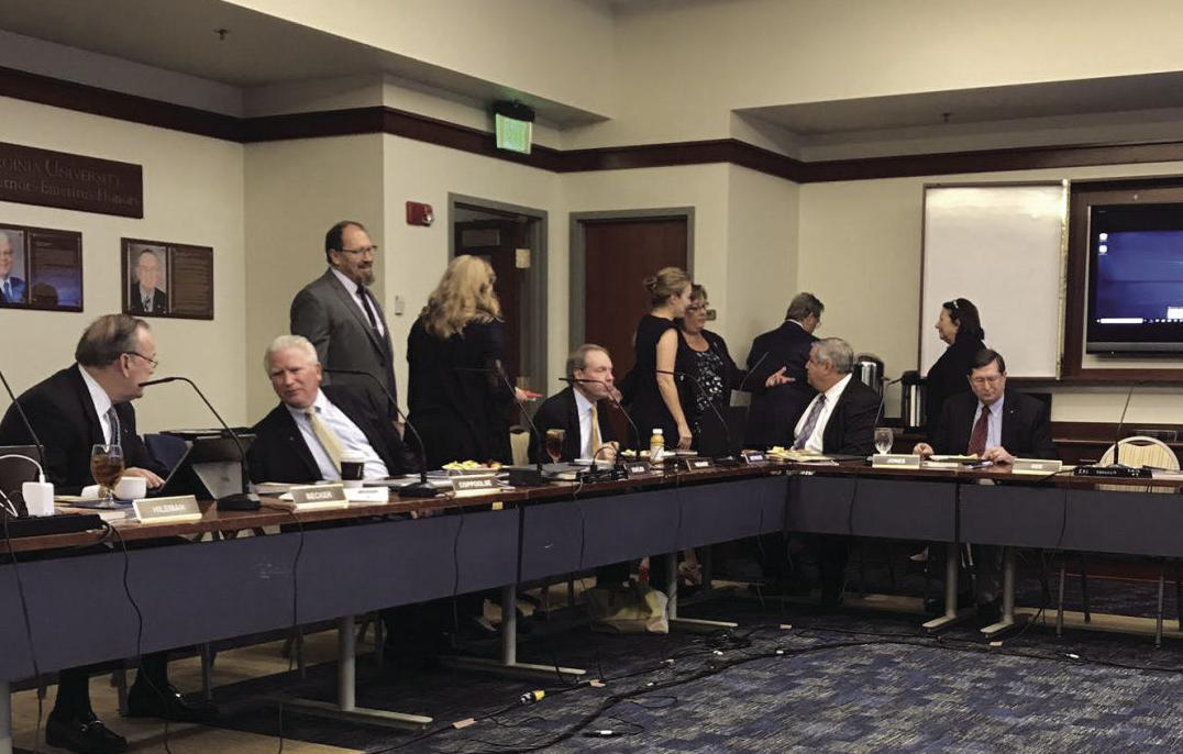 Here, the Board of Governors are pictured during a 2018 in-person meeting.